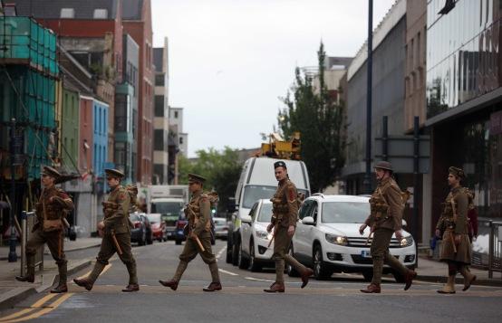 Men in World War I gear in the High Street, Swansea, south Wales UK. Friday 01 July 2016